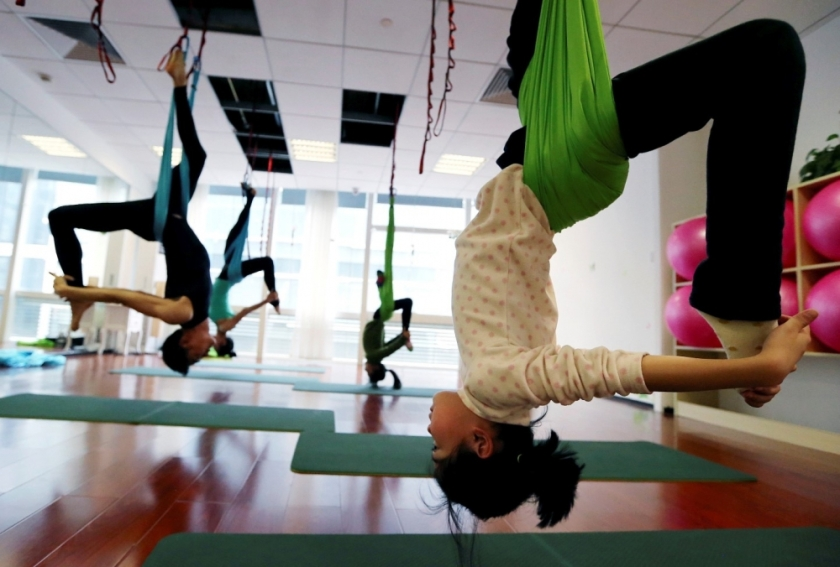 students-practice-antigravity-yoga